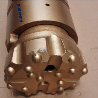 Excentric casing advancement drilling system